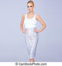 Tall elegant blond woman in a slim line skirt