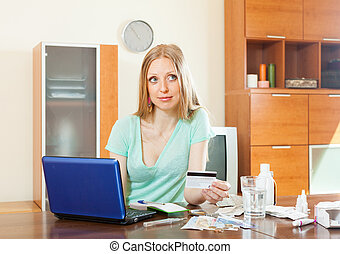 Blonde woman choosing medication online