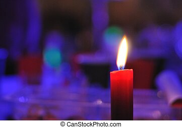 Candle with purple background - Burning candle on right of...