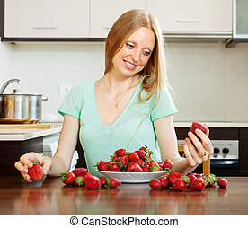 blonde long-haired girl with strawberry - Happy blonde...