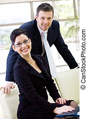 Business people smiling - Happy business people sitting at...