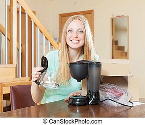 young woman with new coffee machine - Happy young woman with...
