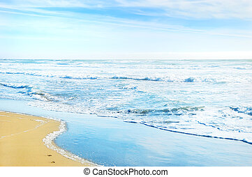 Beach in San Francisco California with waves coming to the...