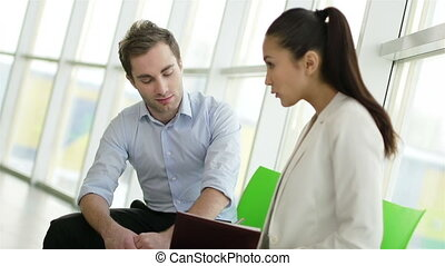Discussing plan - Young businessman and his secretary...