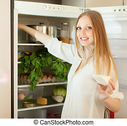 long-haired woman near opened refrigerator - Positive...