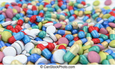 Pills and capsules on a table - different pills and capsules...