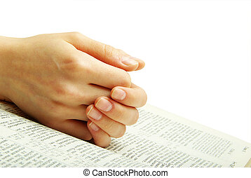bible - hands clasped in prayer over a  Bible