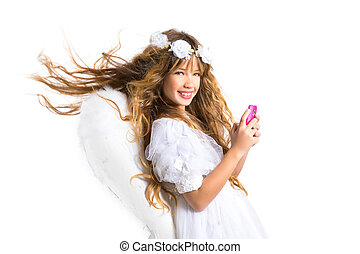 Angel blond girl with mobile phone and feather wings on...