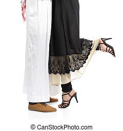 Arab saudi emirates couple legs hugging isolated on a white...