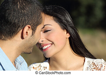 Arab casual couple flirting ready to kiss with love - Close...