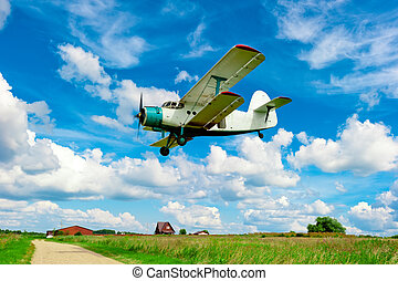 agricultural aircraft flying low over a field