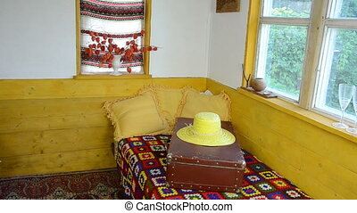 suitcase straw hat - rural room on a mottled bedspreads bed...