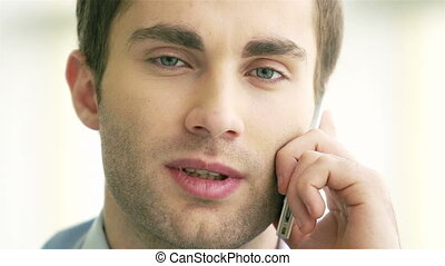 Man calling - Young man speaking on cellular phone