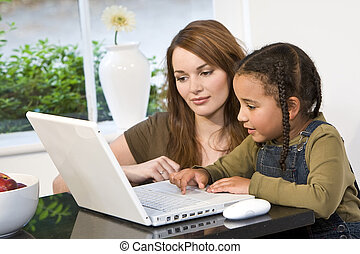 Home Schooling - A beautiful young mother and her mixed race...