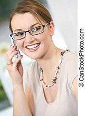Intelligent Communication - A beautiful young brunette woman...