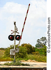 Level crossing - An open level crossing gate in countryside