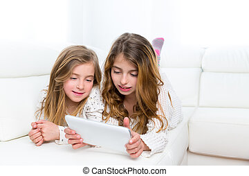 Children friends kid girls playing together with tablet pc -...