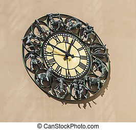 Wall clock with figurines zodiac signs. Oslo. Norway