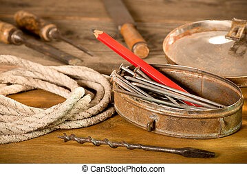 Old Tools - still life with nails and rope in the workroom