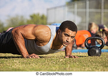 Handsome Man Doing Push-Ups - Handsome Black man with large...