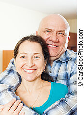Happy elderly man with  smiling girlfriend