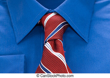 Shirt and Tie - Closeup view of a blue shirt and a striped...