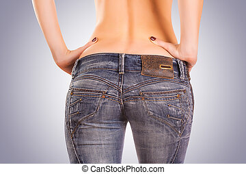 sexy woman Booty in gray jeans on the blue - sexy woman...