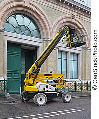 Construction lift - Yellow articulated boom lift for...