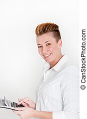 Smiling vivacious woman with a modern hairstyle