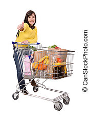 woman with shopping cart - happy brunette woman with...
