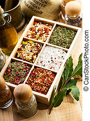 various spices in wooden box