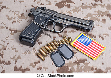 Beretta hand gun on  desert marines uniform
