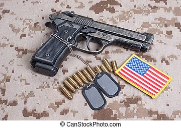 Beretta hand gun on  desert marines uniform