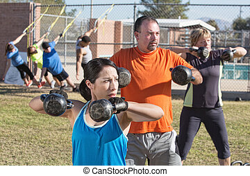 Men and Women in Boot Camp Fitness - Men and women in boot...