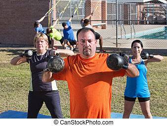 Adults Using Kettle Bell Weights