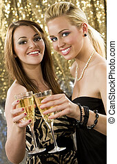 Clubbing Fun - Two beautiful young women enjoying champagne...