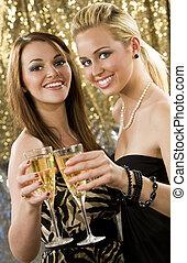 Clubbing Fun - Two beautiful young women enjoying champagne...