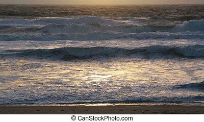 Sunset storm waves crashing
