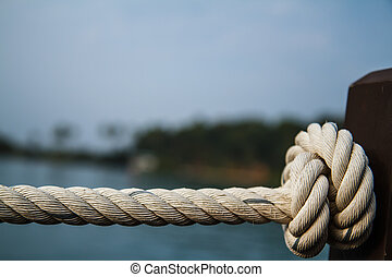 White rope tied into a knot.