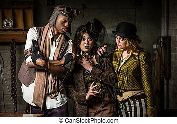 Steampunk Trio with Phone - Three Steampunks with...
