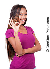 I am OK! Happy young African woman showing her hands with thumbs up while standing isolated on white