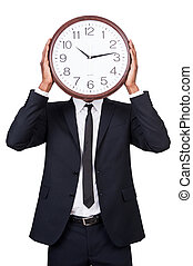 Time management Man in formalwear holding clock over his...