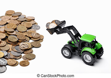 Green tractor raking up coins, white background