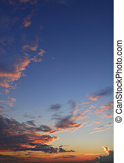 Vibrant blue, orange and golden sunset in the clouds,...