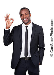 Gesturing OK sign. Handsome young African man in full suit...