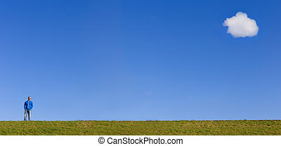 Man standing on top of a dike