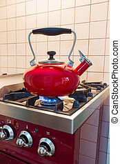 Water kettle heating up on the stove - Red water kettle...