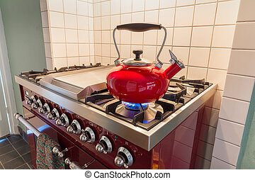 Kettle heating up on the stove - Red kettle heating up on...