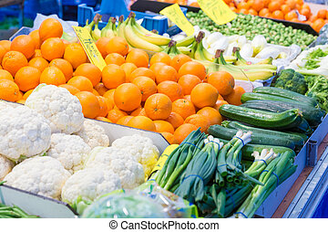 Selection of vegetables and fruit on display at a street...