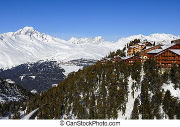 Alpine resort, Mont Blanc mountain range at background.